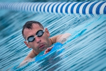 B.J. Lange, a Warrior CARE athlete, moves toward the edge of the pool in the swimming session of the adaptive sports camp at Eglin Air Force Base, Fla., April 27. The base hosts the week-long Wound Warrior CARE event that helps recovering wounded, ill and injured military members through specific hand-on rehabilitative training. (U.S. Air Force photo/Samuel King Jr.)