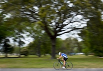 A Warrior Games athlete speeds by during a cycling session at the Air Force team's training camp at Eglin Air Force Base, Fla., April 27. The base-hosted, week-long Warrior Games training camp is the last team practice session before the yearly competition in June. (U.S. Air Force photo/Samuel King Jr.)