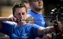 Melinda Smith, a Warrior Games athlete, takes aim at the bullseye during an archery session at the Air Force team's training camp at Eglin Air Force Base, Fla., April 27. The base-hosted, week-long Warrior Games training camp is the last team practice session before the yearly competition in June. (U.S. Air Force photo/Samuel King Jr.)