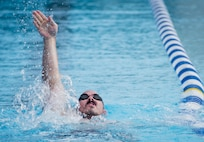 Tech. Sgt. Jason Caswell, a Warrior Games athlete, practices the backstroke during a swimming session at the Air Force team's training camp at Eglin Air Force Base, Fla., April 27. The base-hosted, week-long Warrior Games training camp is the last team practice session before the yearly competition in June. (U.S. Air Force photo/Ilka Cole)