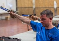A Warrior CARE athlete, Corey Stanley aims his air pistol during a shooting session at the adaptive sports camp at Eglin Air Force Base, Fla., April 26. The base hosts the week-long Wounded Warrior CARE event that helps recovering wounded, ill and injured military members through specific hand-on rehabilitative training. (U.S. Air Force photo/Ilka Cole)