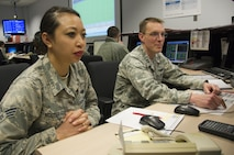 SCHRIEVER AIR FORCE BASE, Colo. -- Senior Airman Hannah Nguyen and Capt. Cuyler Gembol, 6th Space Operations Squadron, monitor satellite activity during a Continuity of Operations training event with the National Oceanic and Atmospheric Administration on Monday, Apr. 24th, 2017. 6 SOPS provides backup to NOAA, the main operators of the Defense Meteorological Satellite Program (DMSP) satellites, in the event that NOAA's systems become inoperable. (U.S. Air Force photo/Senior Airman Laura Turner)