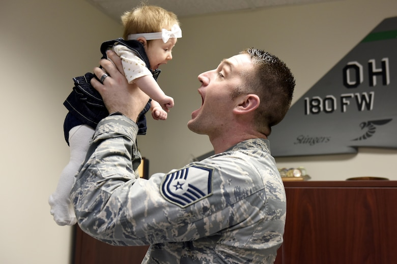 The latest recruit at the 180FW, Finley, came to work with her father, Master Sgt. Brad Haas, a recruiter assigned to the wing. There are more than 200,000 military children under the age age of five with parents in the National Guard or Reserves. These children face all the same challenges of other children growing up, but they also face the added struggle of parents who might deploy to distant locations, even combat zones, for long periods of time, missing major milestones such as birthdays, school recitals, and sporting events. Air National Guard Photo by Airman Hope Geiger