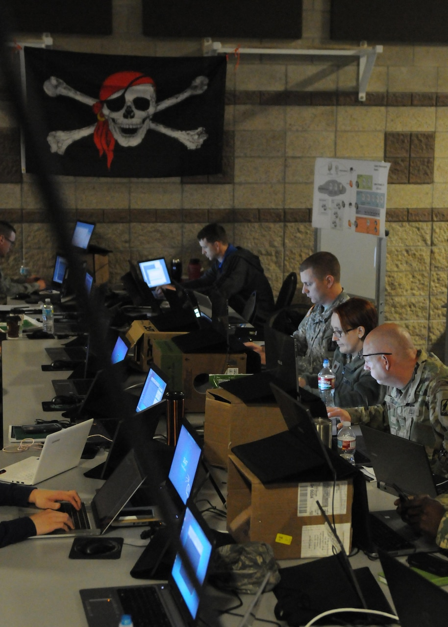 Members of the Army National Guard, Air National Guard, Army Reserve and civilian agencies prepare to engage in cyberattacks as Red Cell members in Cyber Shield 17 at Camp Williams, Utah, April 27, 2017. The National Guard is working closely with its interagency partners and the private sector to strengthen network cybersecurity and capabilities to support local responses to cyber incidents in Cyber Shield 17. Army photo by Sgt. Michael Giles