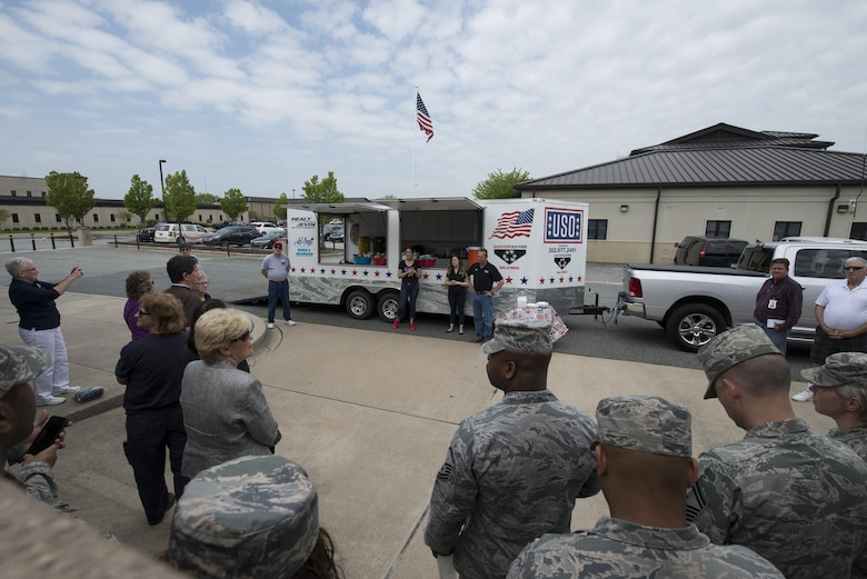Military members and USO Delaware volunteers gather for the dedication of a new food trailer April 27, 2017, at the USO headquarters on Dover Air Force Base, Del. The food truck will be used at military appreciation and recruiting events throughout the state. (U.S. Air Force photo by Senior Airman Aaron J. Jenne)