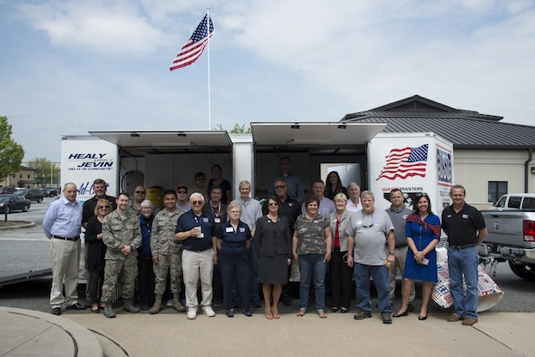USO Delaware volunteers stand in front of a new food trailer during its dedication ceremony April 27, 2017, at the USO headquarters on Dover Air Force Base, Del. Volunteers distributed free food to USO guests during the food trailer's inauguration. (U.S. Air Force photo by Senior Airman Aaron J. Jenne)