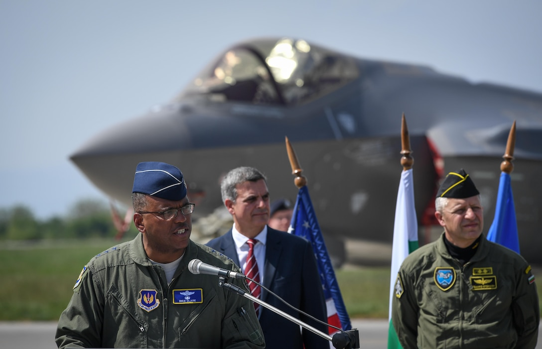 Lt. Gen. Richard Clark, 3rd Air Force commander, speaks to U.S. and Bulgarian visitors as well as media during a press event at Graf Ignatievo Air Base, April 28, 2017, highlighting the first training deployment of the F-35A Lightning II to Bulgaria. Eight F-35s deployed from Hill Air Force Base, Utah to RAF Lakenheath, England on April 15. Two of the eight forward deployed to Bulgaria for a brief time which allowed the F-35s to engage in familiarization training within the European theater while reassuring allies and partners of U.S. dedication to the enduring peace and stability of the region. The F-35s are assigned to the 34th Fighter Squadron and are supported by total force Airmen from the 388th Fighter Wing, and the Air Force Reserve's 466th Fighter Squadron, 419th Fighter Wing, Hill Air Force Base, Utah. A KC-135 Stratotanker assigned to the 459th Air Refueling Wing provided the aerial refueling capability allowing the aircraft to fly non-stop to their destination. (U.S. Air Force photo by Tech. Sgt. Ryan Crane)