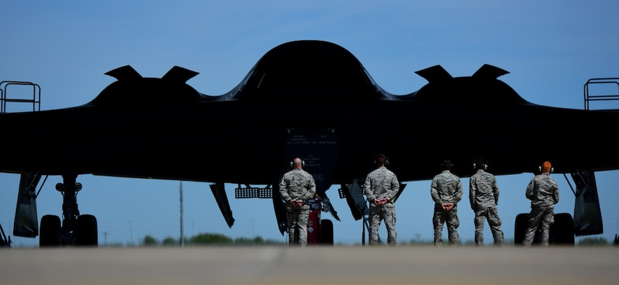 "U.S. Air Force Chief Master Sgt. Darron Hunter, the 509th Maintenance Group (MXG) superintendent, performs pre-flight checks on a B-2 Spirit and signals to the mission commander that he is clear and free to move to the runway at Whiteman Air Force Base, Mo., April 24, 2017. During Hunter's first assignment at Whiteman, he served as the dedicated crew chief (DCC) on the Spirit of Kitty Hawk, tail number 93-1086, from 2000 to 2002, before moving into Quality Assurance and Production for another seven years. In 2015, Hunter returned to the 509th as the MXG superintendent, bringing his career full circle before retiring. For one last farewell, Hunter once more performed the role of the DCC for his old aircraft, ""1086."" (U.S. Air Force photo by Airman 1st Class Jazmin Smith)"