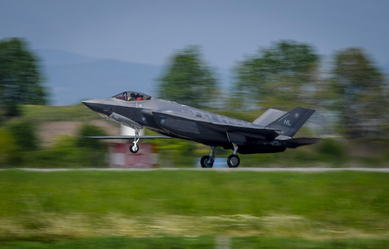 A U.S. Air Force F-35A Lightning II aircraft touches down at Graf Ignatievo Air Base, Bulgaria, April 28, 2017, marking the first time the NATO country has hosted the 5th generation fighter aircraft. Eight F-35s deployed from Hill Air Force Base, Utah to RAF Lakenheath, England on April 15. Two of the eight forward deployed to Bulgaria for a brief time which allowed the F-35s to engage in familiarization training within the European theater while reassuring allies and partners of U.S. dedication to the enduring peace and stability of the region. The F-35s are assigned to the 34th Fighter Squadron and are supported by total force Airmen from the 388th Fighter Wing, and the Air Force Reserve's 466th Fighter Squadron, 419th Fighter Wing, Hill Air Force Base, Utah. A KC-135 Stratotanker assigned to the 459th Air Refueling Wing provided the aerial refueling capability allowing the aircraft to fly non-stop to their destination. (U.S. Air Force photo by Tech. Sgt. Ryan Crane)