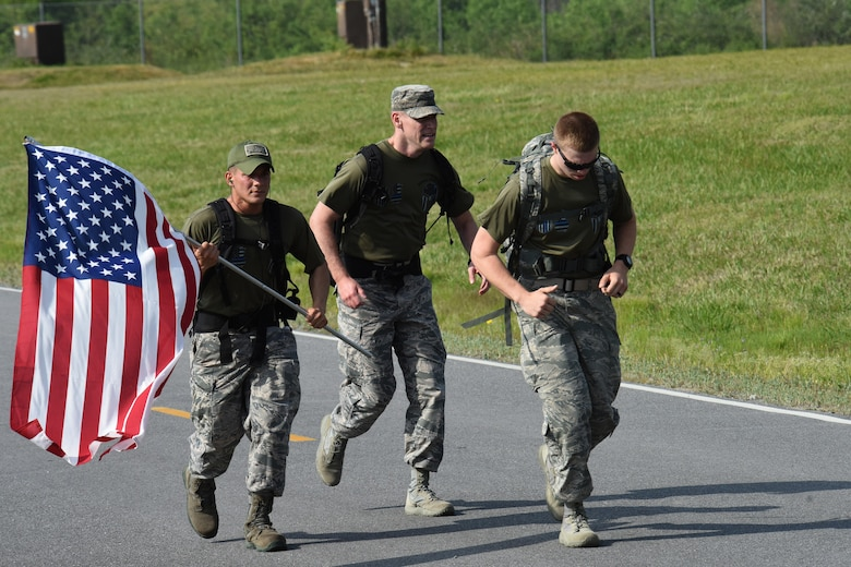 Airman Xavier De Leon (left), and Airman Calahan Ross (right), 4th Security Forces Squadron entry controllers finish an 8.3-mile ruck march during police week, April 17, 2017, at Seymour Johnson Air Force Base, North Carolina. Police week was created in 1962 by then President John F. Kennedy in honor of Peace Officers Memorial Day on May 15. (U.S. Air Force photo by Airman 1st Class Miranda A. Loera)