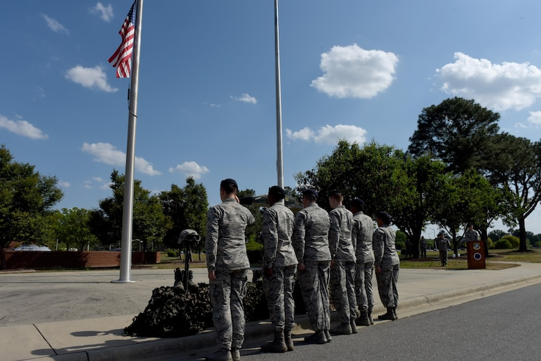 Members of the 4th Security Forces Squadron render salutes to honor the fallen police officers during the closing ceremony of Police week, April 21, 2017, at Seymour Johnson Air Force Base, North Carolina. Police Week is a five-day celebration with events such as an 8.3- mile ruck march, community day and a shoot, move and communicate challenge.  (U.S. Air Force photo by Airman 1st Class Miranda A. Loera)