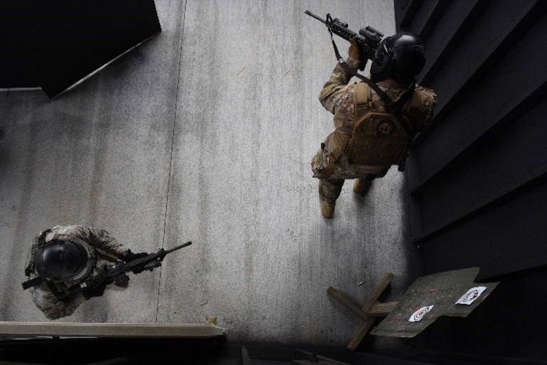 Members of the explosive ordnance disposal flight participated in a shoot, move and communicate challenge during Police week, April 20, 2017, at Seymour Johnson Air Force Base, North Carolina. The competition consisted of a team challenge in which they had to rescue hostages in a timely manner. (U.S. Air Force photo by Airman 1st Class Miranda A. Loera)