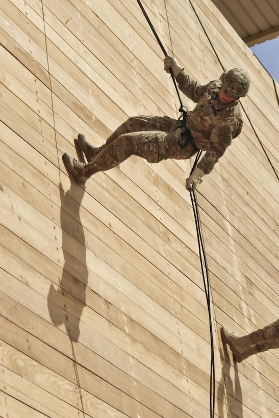Spc. William Lloyd, with the 316th Sustainment Command (Expeditionary), 1st Sustainment Command (Theater), rappels from a tower during a Rappel Master Course at Camp Buehring, Kuwait, April 19, 2017. (U.S. Army photo by Sgt. 1st Class Al Gagow)