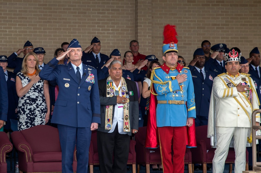 U.S. Air Force Lt. Gen. Darryl Roberson, commander Air Education and Training command, salutes Basic Military Training graduates alongside the 2017 Fiesta Royalty April 21, 2017 at the Graduation Parade at Lackland Air Force Base, T.X. This year marks the 126th anniversary of the colorful Fiesta festivity, honoring traditions deeply rooted throughout the area and celebrating the historic partnerships between the Airmen of Joint Base San Antonio and the local community. (U.S. Air Force photo by Johnny Saldivar)