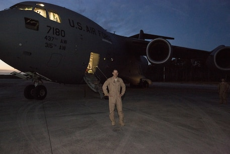 MARINE CORPS AIR STATION CHERRY POINT, N.C. – U.S. Air Force Maj. Robert Riggs, U.S. Marine Corps Forces, Special Operations Command air mobility liaison officer (AMLO), prepares for his C-17 mission on the flight line at MCAS Cherry Point, N.C. Riggs drove down to Charleston, S.C., to operate the C-17 scheduled to deploy a Marine Special Operations Company to Africa and bring back a separate MSOC. The total flight took four days and visited four different countries on three continents. (U.S. Marine Corps photo by Sgt. Salvador Moreno, released)