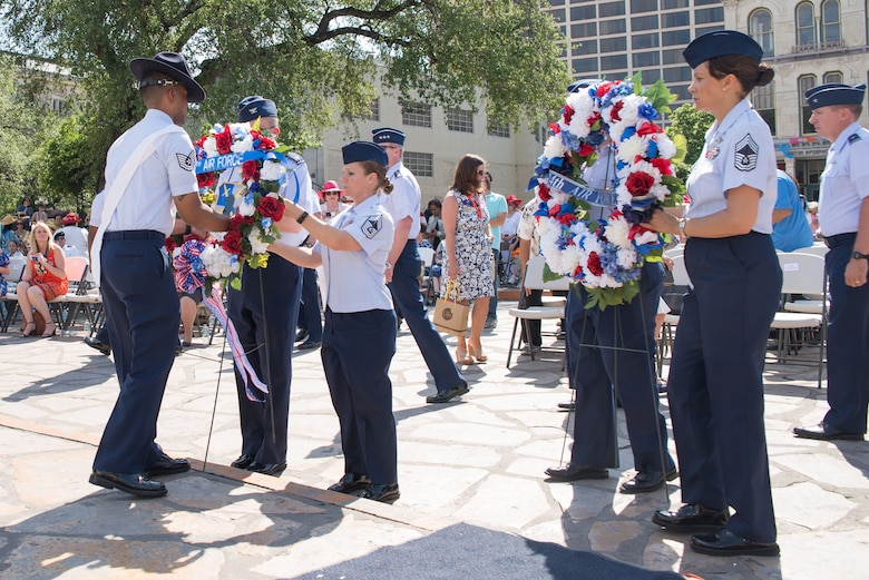 Airmen from Joint Base San Antonio place memorial wreaths during the 2017 Pilgrimage to the Alamo as part of Fiesta San Antonio April 24, 2017. The Pilgrimage to the Alamo includes a march through downtown San Antonio and ends with a wreath laying ceremony in honor of those who fought in the Battles of the Alamo and San Jacinto. Servicemembers from around JBSA participate in Fiesta San Antonio activities representing the progression of the United States military. (U.S. Air Force photo by Andrew Patterson)