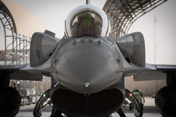 A Polish air force pilot performs preflight checks in an F-16 Fighting Falcon before taxiing for a mission at the 407th Air Expeditionary Group, April 24, 2017. The Polish Airmen are part of the 60-nation coalition force supporting Operation Inherent Resolve in the fight against ISIS. (U.S. Air Force photo/Master Sgt. Benjamin Wilson)(Released)