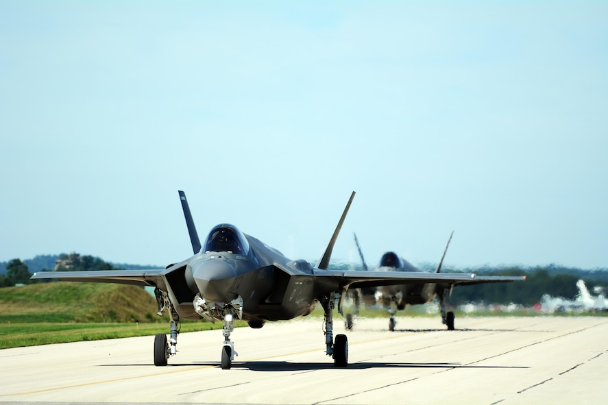 Two F-35A Lightning II jets taxi down the taxiway at Volk Field Air National Guard Base, Camp Douglas, Wis., during the Northern Lightning exercise Aug. 23, 2016. The exercise was a tactical-level, joint training exercise that emphasized fourth and fifth generation assets engaged in a contested, degraded environment.(U.S. Air National Guard photo by Staff Sgt. Kyle Russell)(released)