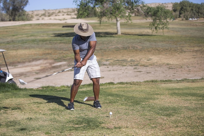Sgt. James Thomas, maintenance chief, 3rd Assault Amphibian Battalion, tees off during the Earth Day Golf Tournament at Desert Winds Golf Course, Marine Corps Air Ground Combat Center, Twentynine Palms, Calif., April 21, 2017. Natural Resources and Environmental Affairs held the tournament to help raise awareness of Combat Center patrons to being good stewards of the environment. (U.S. Marine Corps photo by Cpl. Thomas Mudd)