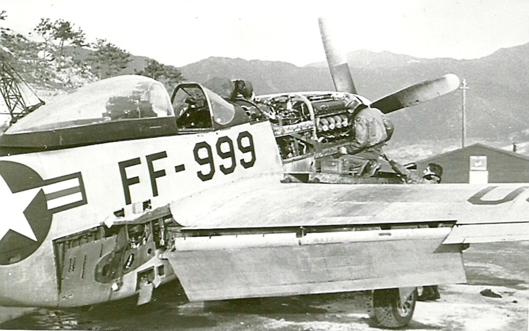 """""""Ernie's"""" Mustang, FF-999, undergoes a 100 hour inspection by a maintenance team, K-46 Air Base, Korea, 1951."""