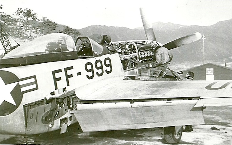"""Ernie's"" Mustang, FF-999, undergoes a 100 hour inspection by a maintenance team, K-46 Air Base, Korea, 1951."