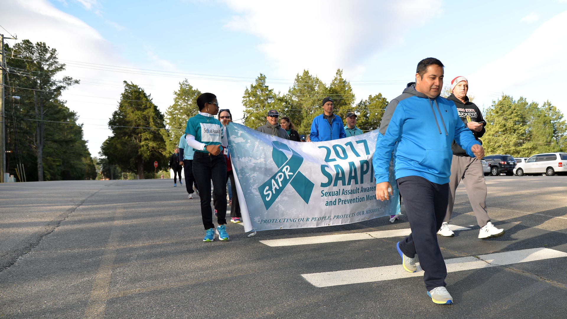 """Despite low temperatures and high winds, Defense Contract Management Agency Fort Lee, Virginia, personnel marked Sexual Assault Awareness and Prevention Month with its annual 5k April 7. Equal Employment Opportunity partnered with the agency's Work Life team to highlight the month's 2017 theme: """"Protecting Our People Protects Our Mission."""" (DCMA photo by Thomas Perry)"""