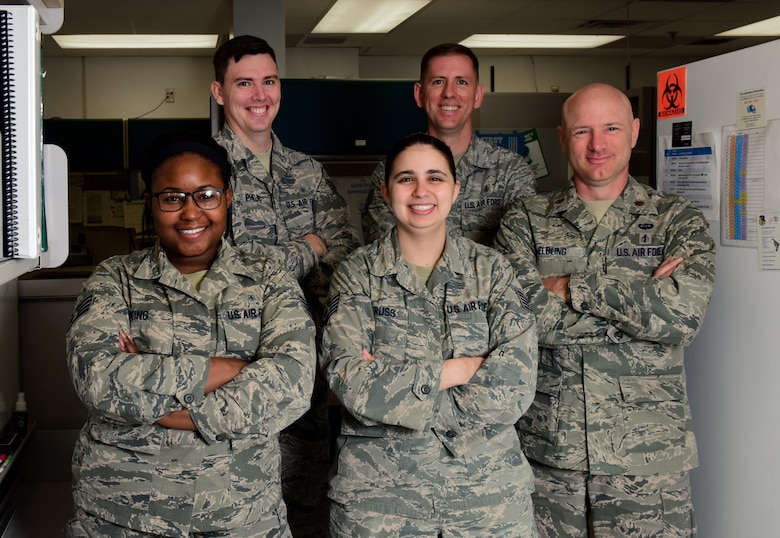 "Airmen assigned to the 509th Medical Support Squadron stop for a photo during ""Medical Laboratory Professionals Week"" at Whiteman Air Force Base, Mo., April 24, 2017. The shop's team is divided into five sections: chemistry, hematology, microbiology, serology and urinalysis. (U.S. Air Force photo by Airman 1st Class Jazmin Smith)"