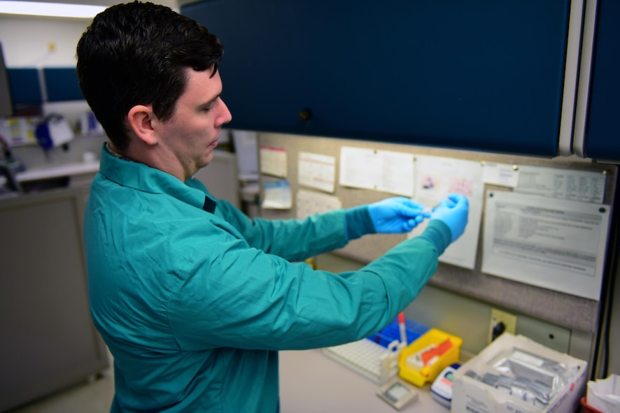 U.S. Air Force Staff Sgt. Daniel Phelps, a laboratory technician assigned to the 509th Medical Support Squadron, tests a throat swab for strep using a rapid strep testing kit at Whiteman Air Force Base, Mo., April 19, 2017. Technicians work hand-in-hand with primary care physicians to provide patients with a proper diagnosis and treatment. (U.S. Air Force photo by Airman 1st Class Jazmin Smith)