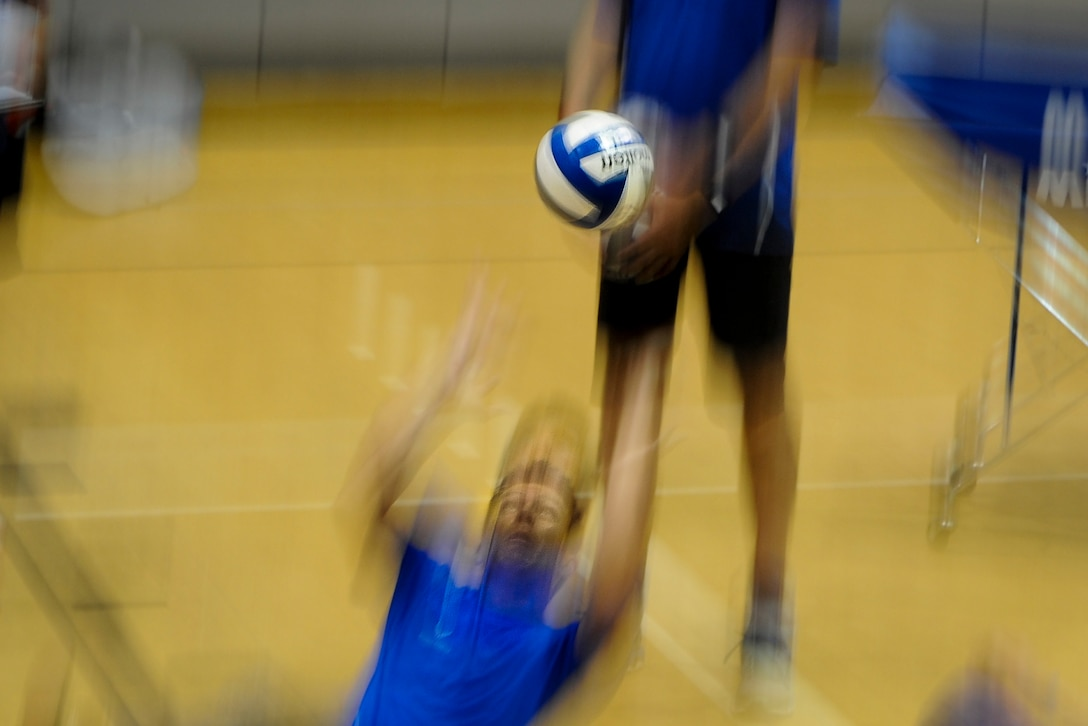 Keary Gwinn, a member of the Air Force sitting volleyball team, sets the volleyball during a scrimmage at Hurlburt Field, Fla., April 24, 2017. The scrimmage was part of training before their annual competition in June. (U.S. Air Force photo by Airman 1st Class Dennis Spain)