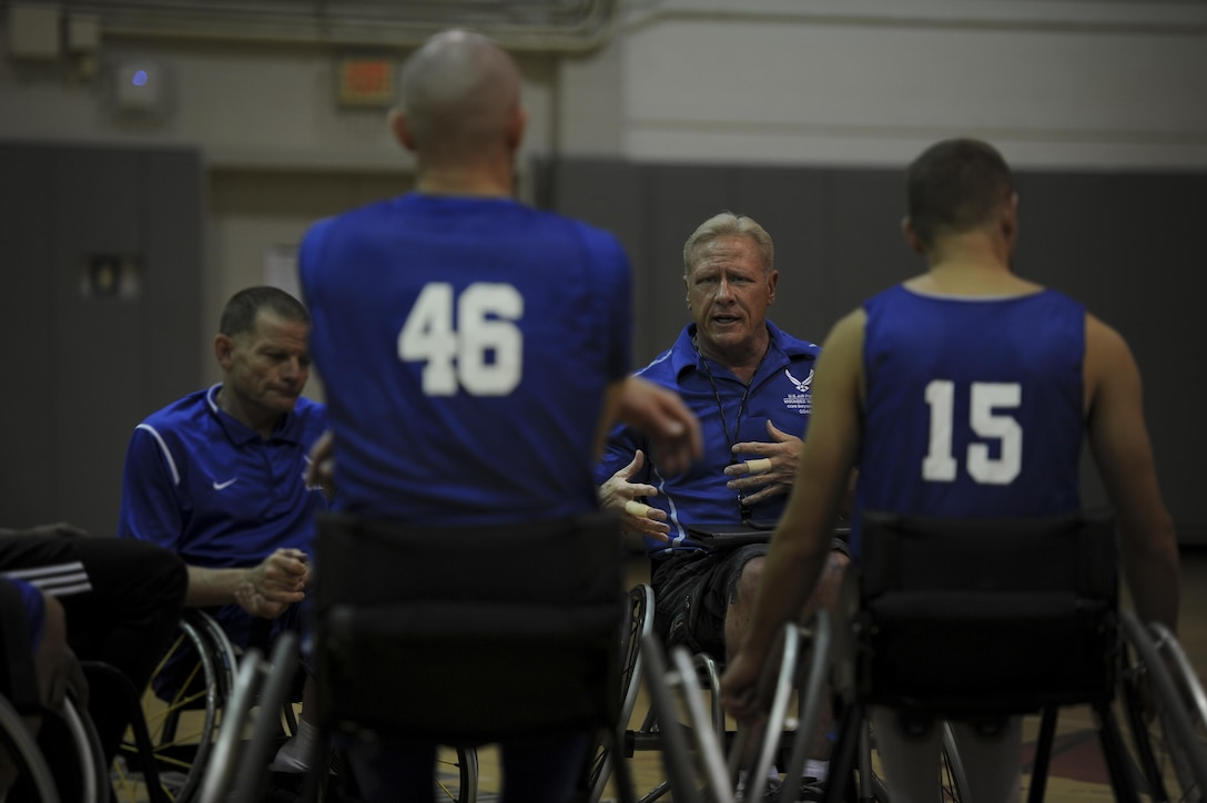 Mark Shepherd, the coach of the Air Force wheelchair basketball team, gives advice to his team during a practice at Hurlburt Field, Fla., April 24, 2017. Shepherd has been coaching for three years. The team is set to compete against other Department of Defense teams in June. (U.S. Air Force photo by Airman 1st Class Dennis Spain)