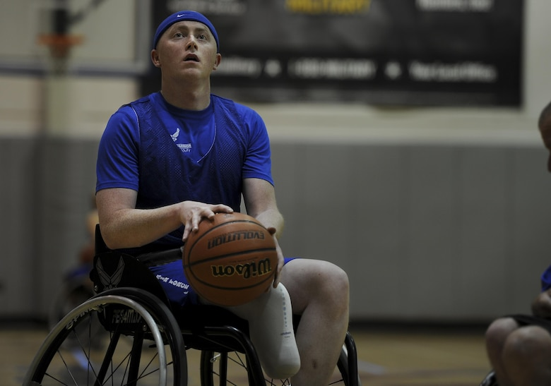 Austin Williamson, a shooting guard with the Air Force wheelchair basketball team, prepares to shoot a free throw during practice at Hurlburt Field, Fla., April 24, 2017. The team is composed of wounded warriors who compete against other Department of Defense teams. (U.S. Air Force photo by Airman 1st Class Dennis Spain)