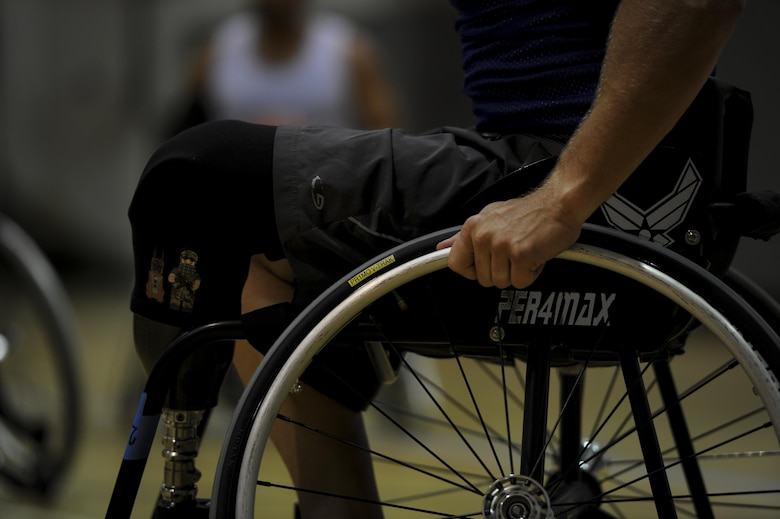 Ben Seekell, a point guard on the Air Force wheelchair basketball team, participates during practice at Hurlburt Field, Fla., April 24, 2017. The AF's team is set to compete with Department of Defense teams in June. (U.S. Air Force photo by Airman 1st Class Dennis Spain)