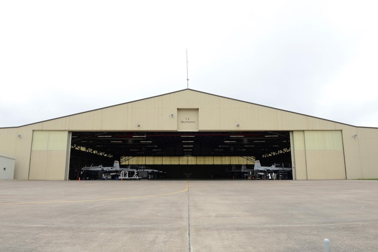 "Laughlin's T-6 maintenance hangar opens its doors on Laughlin Air Force Base, Texas, April 12, 2017. Laughlin's T-6 maintainers have restored nearly all 38 of the T-6 hangar queens on base, putting Laughlin at the top of Air Education and Training Command with the least amount of T-6 hangar queens. A ""hangar queen"" is an aircraft that hasn't been flown in more than 30 days. (U.S. Air Force photo/Airman 1st Class Benjamin N. Valmoja)"