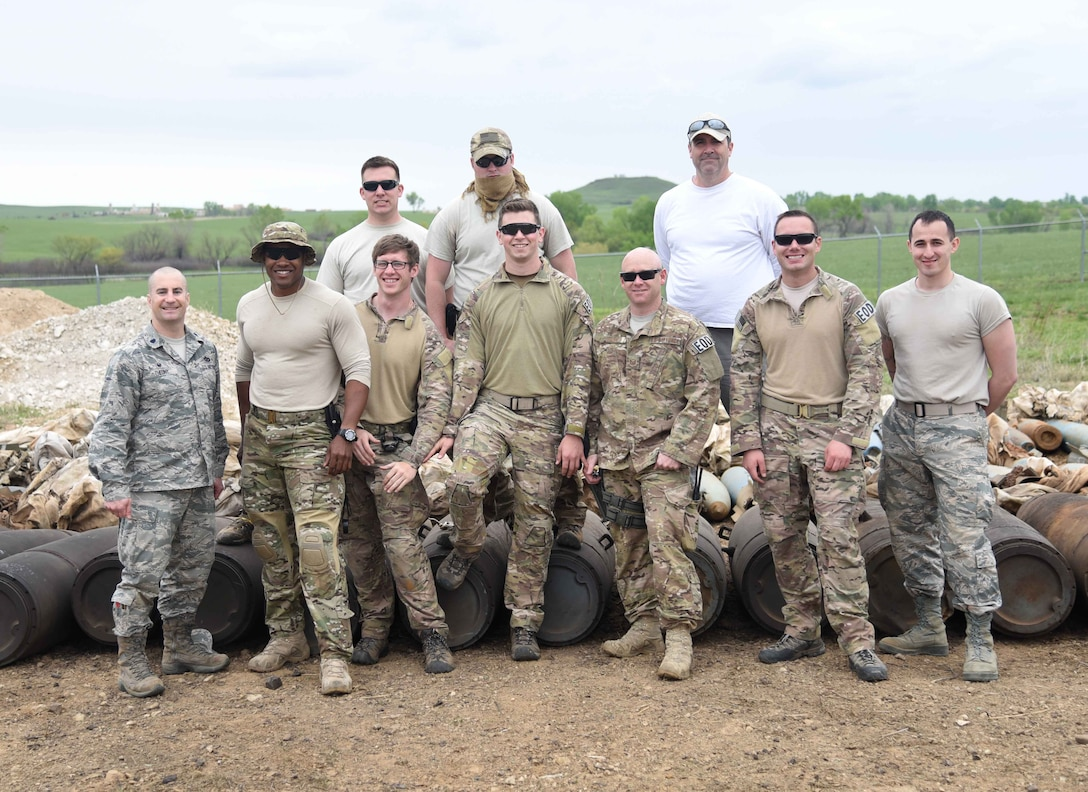 McConnell Airmen pose for a photo April 25, 2017, at Smoky Hill Air National Guard Range, Salina, Kan. The Airmen visited the range April 17-26 to clear it of more than 500 munitions. (U.S. Air Force photo/Airman 1st Class Erin McClellan)