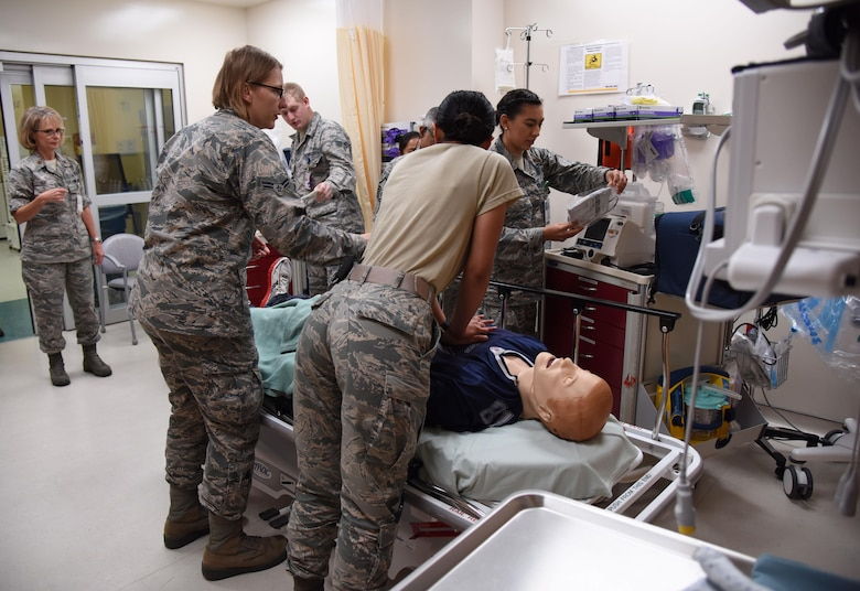 Members of the 81st Medical Operations Squadron participate in a medical emergency scenario during Code Blue Thursday in the Keesler Medical Center emergency room April 27, 2017, on Keesler Air Force Base, Miss. Emergency room staff members coordinated with the simulation lab to use human patient simulators for running various advanced cardiac life support scenarios to improve Keesler's new medical technicians' skills and get them familiar with emergency equipment. (U.S. Air Force photo by Kemberly Groue)