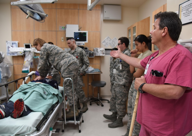 Dale Rowell, 81st Medical Operations Squadron charge nurse, instructs staff members as they participate in a medical emergency scenario during Code Blue Thursday in the Keesler Medical Center emergency room April 27, 2017, on Keesler Air Force Base, Miss. Emergency room staff members coordinated with the simulation lab to use human patient simulators for running various advanced cardiac life support scenarios to improve Keesler's new medical technicians' skills and get them familiar with emergency equipment. (U.S. Air Force photo by Kemberly Groue)