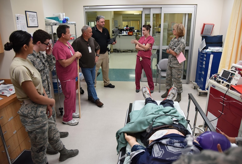 "Members of the 81st Medical Operations Squadron participate in a ""hot wash"" following a medical emergency training scenario during Code Blue Thursday in the Keesler Medical Center emergency room April 27, 2017, on Keesler Air Force Base, Miss. Emergency Room staff members coordinated with the simulation lab to use human patient simulators for running various advanced cardiac life support scenarios to improve Keesler's new medical technicians' skills and get them familiar with emergency equipment. (U.S. Air Force photo by Kemberly Groue)"