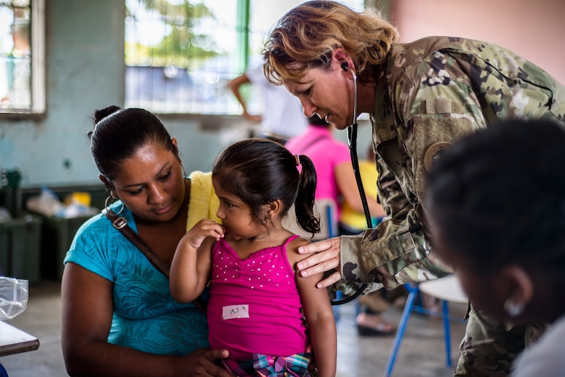 U.S. Army Sgt. 1st Class Lorraine Branson screens Honduran patients for medical problems at a Medical Readiness Training Exercise site at Cooperativa village, Colon, Honduras , Apr. 20, 2017. Joint Task Force – Bravo Medical Element, provided care to more than 850 patients during a Medical Readiness Training Exercise in Cooperativa village, Colon, Honduras, Apr. 20-21, 2017. MEDEL also supported a Military Partnership Engagement and assisted more than 650 patients with the Hondurian Navy in Santa Rosa de Aguan, Colon, Honduras, Apr. 22, 2017. (U.S. Air National Guard photo by Master Sgt. Scott Thompson/released)