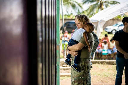 U.S. Army Sgt. 1st Class Lorraine Branson comforts a Honduran child while waiting for medical care at a Medical Readiness Training Exercise site at Cooperativa village, Colon, Honduras , Apr. 20, 2017. Joint Task Force – Bravo Medical Element, provided care to more than 850 patients during a Medical Readiness Training Exercise in Cooperativa village, Colon, Honduras, Apr. 20-21, 2017. MEDEL also supported a Military Partnership Engagement and assisted more than 650 patients with the Hondurian Navy in Santa Rosa de Aguan, Colon, Honduras, Apr. 22, 2017. (U.S. Air National Guard photo by Master Sgt. Scott Thompson/released)