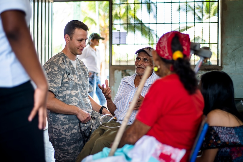 U.S. Army Capt. Adam West provides medical care to Honduran patients at a Medical Readiness Training Exercise site at Cooperativa village, Colon, Honduras , Apr. 21, 2017. Joint Task Force – Bravo Medical Element, provided care to more than 850 patients during a Medical Readiness Training Exercise in Cooperativa village, Colon, Honduras, Apr. 20-21, 2017. MEDEL also supported a Military Partnership Engagement and assisted more than 650 patients with the Hondurian Navy in Santa Rosa de Aguan, Colon, Honduras, Apr. 22, 2017. (U.S. Air National Guard photo by Master Sgt. Scott Thompson/released)