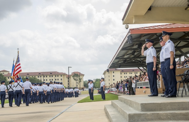 Col. Ken Backes, Air Force Reserve Officer Training Corps Southeast Region Commander, presides over an Officer Training School Commissioned Officer Training graduation, April 28, 2017, Maxwell Air Force Base, Ala. Today, Backes retired after serving 10 years enlisted and 30 years as an officer, totaling to 40 years in service. (U.S. Air Force photo/ Senior Airman Alexa Culbert)