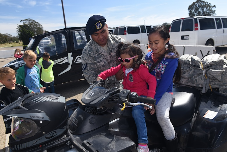 Tech. Sgt. Benjamin Kolise, 30th Security Forces Squadron standards and evaluation, takes his daughters, Terineise and Fiasili, to work during Take Your Child to Work day, April 27, 2017, Vandenberg Air Force Base, Calif. Take Your Child to Work Day gives military youth an opportunity to see what their parents contribute to the space and missile mission. (U.S. Air Force photo by Tech. Sgt. Jim Araos/Released)