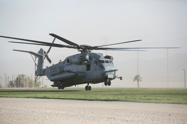 A CH-53 'Super Stallion' helicopter lands at Del Valle Field during a non-combatant Evacuation Operation exercise as part of Weapons and Tactics Instructor Course 2-17 aboard Marine Corps Air Ground Combat Center Twentynine Palms, Calif., April 21, 2017. NEO exercises simulate real-life scenarios where non-combatants are evacuated from a potentially hostile area. (U.S. Marine Corps photo by Cpl. Julio McGraw)
