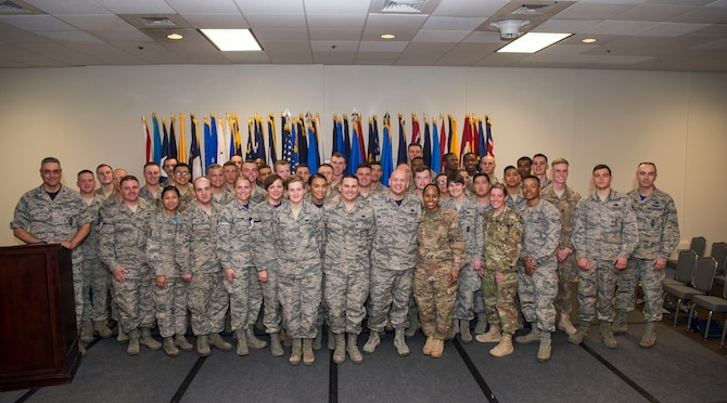 Col. Stephen Kravitsky, 90th Missile Wing commander along with Col. Lloyd Buzzell, 20th Air Force vice commander and Chief Master Sgt. Jeffery Steagall, 90th MW command chief pose for a group photo with enlisted Airmen who promoted in March and April during the wing promotion ceremony on F.E. Warren Air Force Base, Wyo., April 28, 2017. Each month the Mighty Ninety hosts a ceremony to recognize the promotees from the base. (U.S. Air Force photo by Staff Sgt. Christopher Ruano)