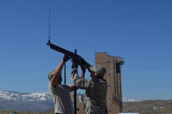 Two Nevada Air National Guard Joint Incident Site Communications Capability (JISCC) members, Senior Airman David Almada (right) and Staff Sgt. Jesse Lemos assemble an antenna mast at the Regional Public Safety Training Center in Reno, Nevada, during the 2017 practice exercise. The team, along with the Nevada Air National Guard's CBRNE (Chemical, Biological, Radiological, Nuclear and High Yield Explosive) Enhanced Response Force Package (CERFP) will have their annual ExEval inspection in June.
