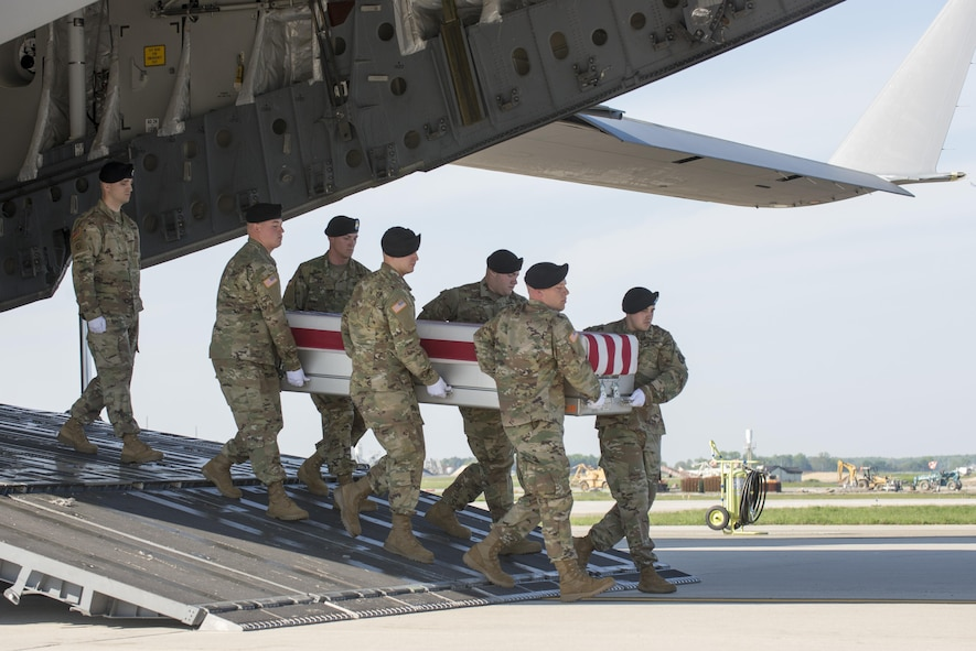 A U.S. Army carry team transfers the remains of Army Sgt. Joshua P. Rodgers of Bloomington, Ill., April 28, 2017, at Dover Air Force Base, Del. Rodgers was assigned to the 3rd Battalion, 75th Ranger Regiment, Fort Benning, Ga. (U.S. Air Force photo by Staff Sgt. Jared Duhon)