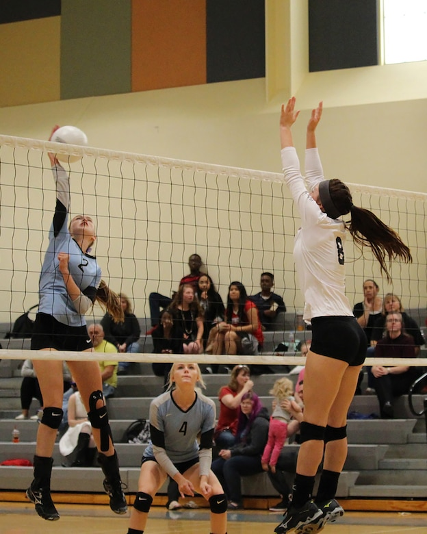 Emily Donovan, daughter of Senior Master Sgt. Rebecca Donovan, 168th Force Development superintendent, goes up for a block during a match earlier this year. Emily, a senior at Ben Eielson High School, Eielson AFB, Alaska, signed her college letter of intent today, April 27, 2017, agreeing to play volleyball for Tennessee Wesleyan University. (Courtesy photo by Senior Master Sgt. Rebecca Donovan/Released)
