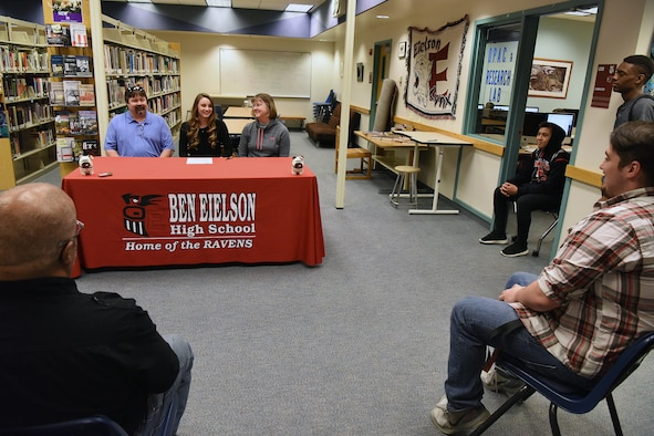 Emily Donovan, daughter of Senior Master Sgt. Rebecca Donovan, 168th Force Development superintendent, Alaska Air National Guard, answers questions from Devin Fry, sports anchor from Fairbanks' CBS affiliate, and Danny Martin, sports editor of Fairbanks Daily News-Miner, inside the Ben Eielson High School library, April 27, 2017, Eielson AFB, Alaska. Donovan, will be playing college volleyball in Tennessee and will study exercise science and sports psychology. (U.S. Air National Guard photo by Senior Master Sgt. Paul Mann/Released)