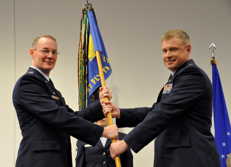 Lt. Col. Allen Duckworth (right) took command of the 97 FTS in Change of Command ceremonies at Sheppard Air Force Base, Texas, April 28. Here, Duckworth accepts the 97 FTS guidon from Col. Roger Suro, Commander of the 340th Flying Training Group, Joint Base San Antonio-Randolph-Texas. These ceremonies represent the formal passing of responsibility, authority and accountability of command from one officer to another (U.S. Air Force photo