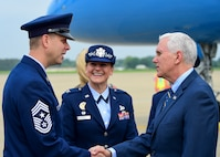 U.S. Vice President Michael R. Pence is greeted by U.S. Air Force Chief Master Sgt. Kennon Arnold, 633rd Air Base Wing command chief, and U.S. Air Force Col. Caroline Miller, 633rd ABW commander, at Joint Base Langley-Eustis, Va., April 29, 2017. After visiting JBLE, Pence presented a keynote speech for the Christening Ceremony of the U.S. Navy's newest attack submarine at the Newport News Shipyard. (U.S. Air Force photo/Senior Airman Derek Seifert)